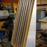 The Acoustic Ramp™ V1.0 front view on the bench at Redco's machine shop