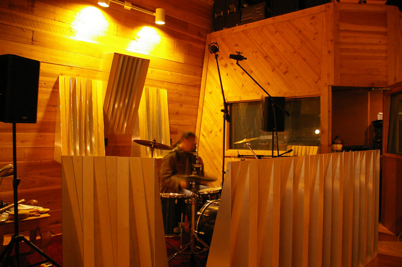Playing Drums Inside a Corral of Acoustic Ramps